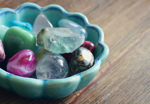 Crystal healing stones in a bowl